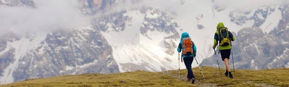 Couple hiking in the rain, Italian Dolomites